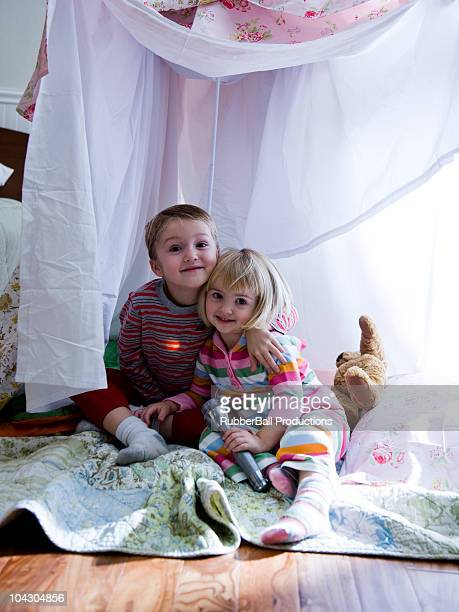 brother and sister in a makeshift fort