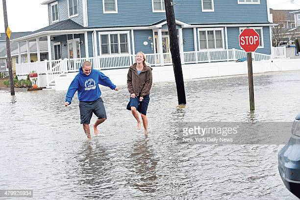 Brother and sister in the flooded streets as Hurricane Sandy starts hitting Breezy Point in The Rockaways Queens NY