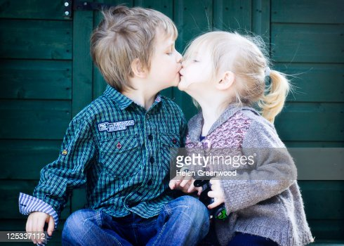 Sister and brother kiss