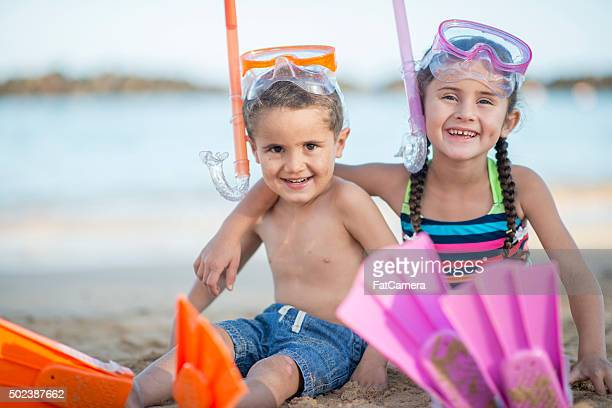 Brother and Sister Laughing on the Beach