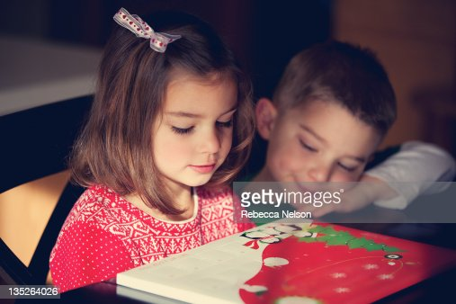 Brother and sister looking at Advent calendar