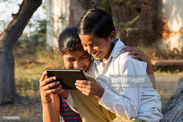 Brother and sister looking at tablet device