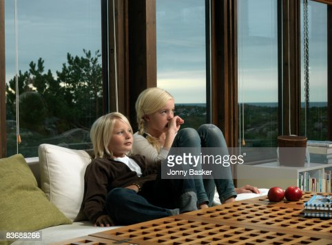 Brother and sister on couch : Stock Photo