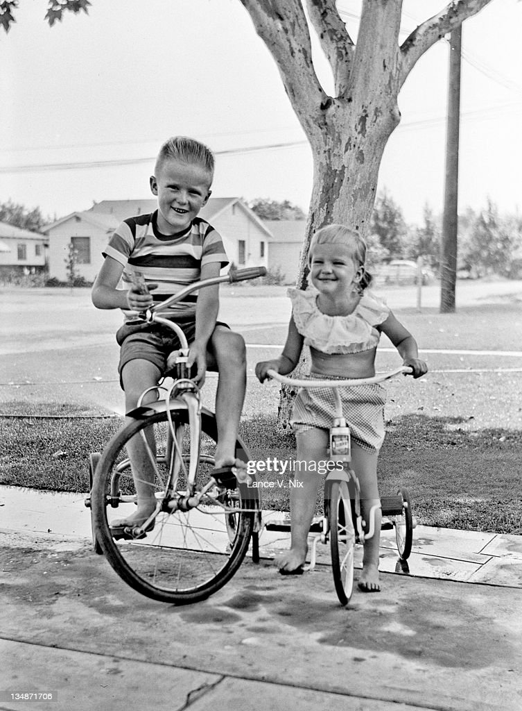 Brother and sister on cycle : Stock Photo