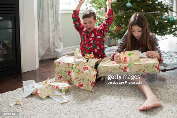 Brother and sister opening christmas presents