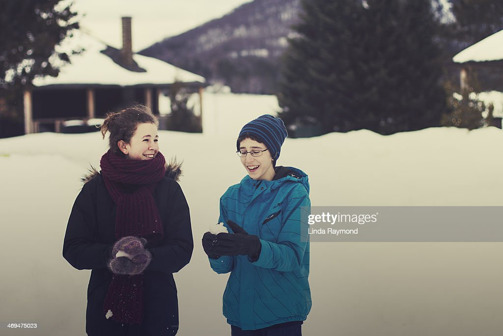 brother and sister playing with snow : Stock Photo