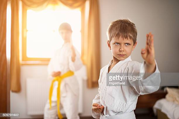 Brother and sister practicing karate