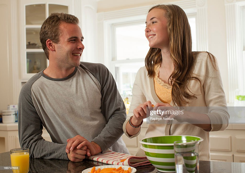 Brother and sister preparing food : Stock Photo