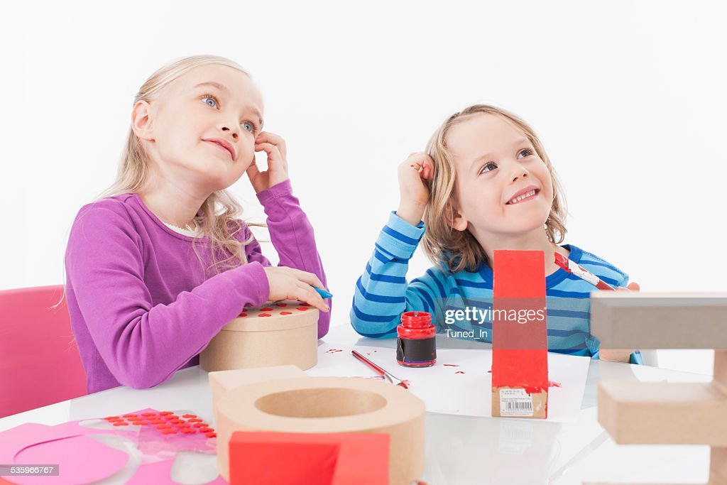 Brother and sister preparing gift : Stock Photo