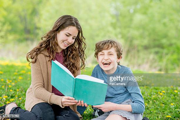 Brother and Sister Reading in the Park