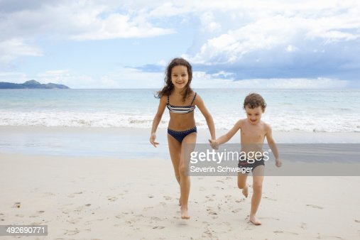 brother and sister naked and holding hand