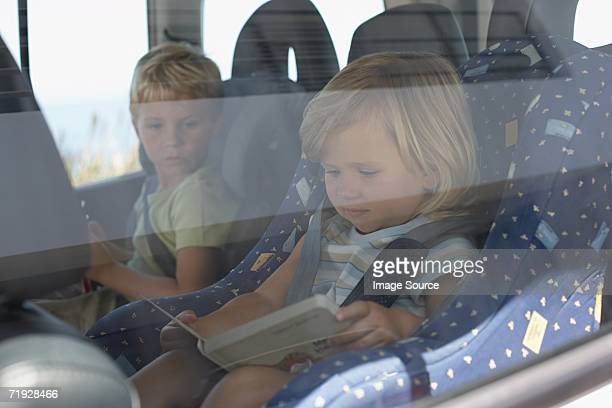 Brother and sister sat in car