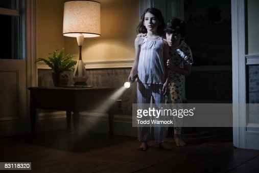 brother and sister searching with flashlight : Stock Photo