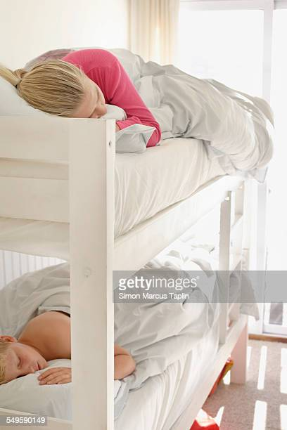 Brother and Sister Sleeping in Bunk Beds