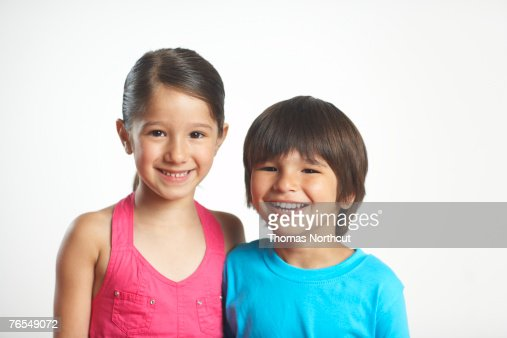 Brother and sister (4-6) smiling, portrait, close-up : Stock Photo