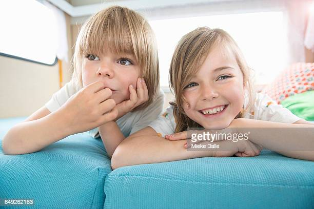 brother and sister spending time in a  caravan