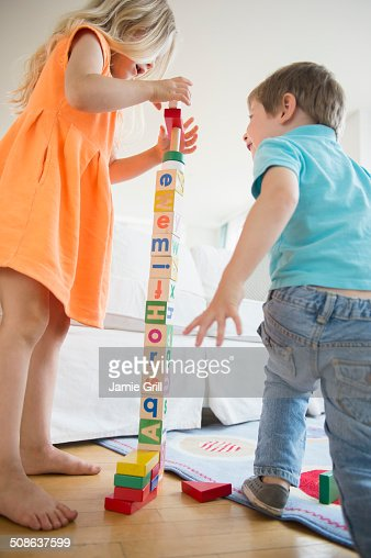 Brother and sister stacking blocks together