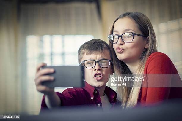 Brother and sister taking selfie