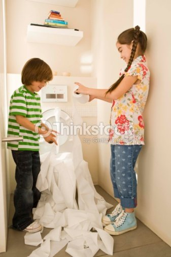 Brother and sister unrolling toilet paper in bathroom   Stock Photo. Brother And Sister Unrolling Toilet Paper In Bathroom Stock Photo