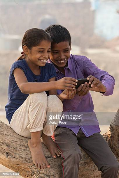 Brother and sister using a smartphone