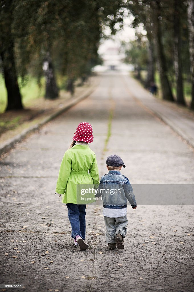 Brother and sister walking