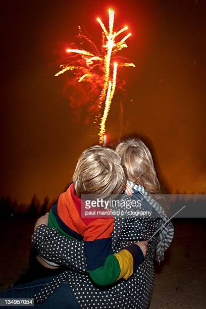 Brother and sister watching fireworks
