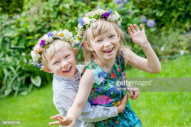 Brother and sister wearing flower wreaths