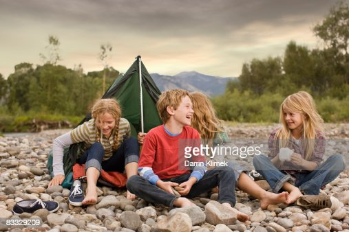 Brother and sisters playing in small tent : Stock Photo
