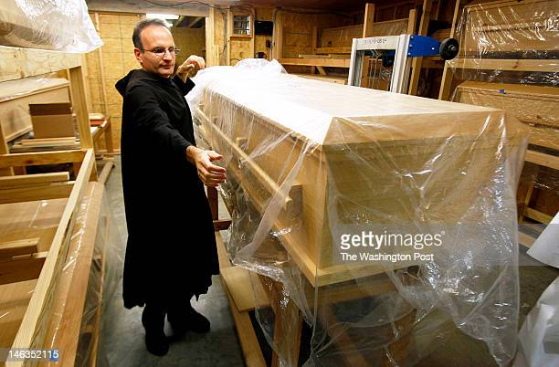 Brother Emmanuel Labrise of St Joseph's Abbey prepares a casket for lining on May 15 2012 in Covington Louisiana Louisiana law forbids those who are...