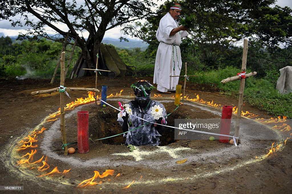'Brother Hermes' performs an exorcism on Claudia Gaviria who claims to be possessed by spirits on June 1 in La Cumbre Valle del Cauca department...