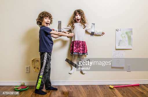 Brother hung her sister on the wall