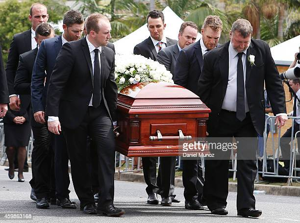 Brother Jason and father Greg carry the coffin during the Funeral Service for Phillip Hughes on December 3 2014 in Macksville Australia Australian...