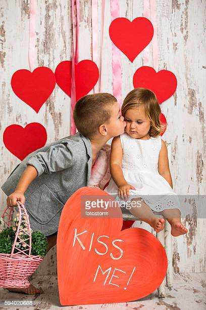 Brother kissing his little sister