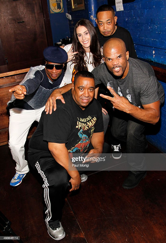 Brother Marquis DJ Charlie Chan Ashley Spillane President Rock the Vote Fresh Kid Ice and Darryl 'DMC' McDaniels pose for a photo backstage at Rock...
