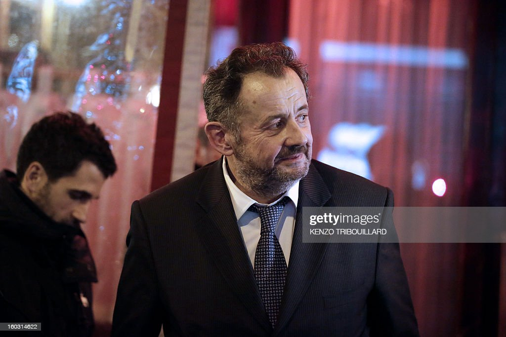 Brother of French former President Nicolas Sarkozy, Guillaume leaves the Rebelatto restaurant after a dinner with relatives to celebrate Nicolas Sarkozy's 58th birthday, on January 28, 2013 in Paris.