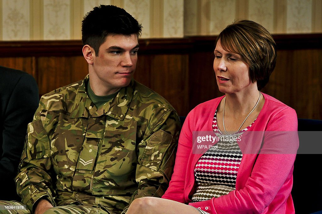 Brother of James and serving soldier Coran Ashworth and his mother Kerry Ashworth react as James Ashworth's citation is read out at a press conference at Buller Barracks on March 18, 2013 in Aldershot, England. Lance Corporal James Ashworth has been awarded the Victoria Cross in recognition of his 'extraordinary courage' while serving with the 1st Battalion The Grenadier Guards in Helmand province where he died last June.