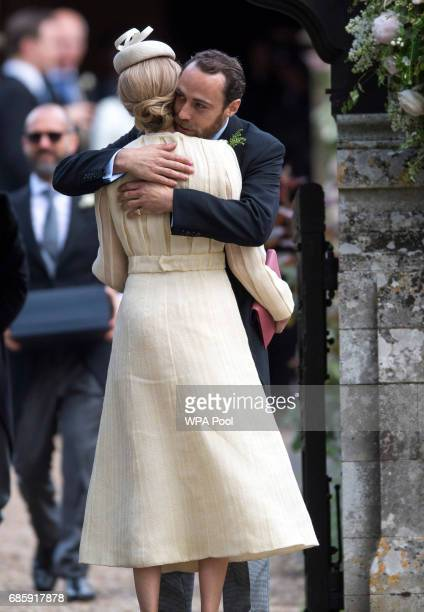 Brother of Pippa James Middleton embraces girlfriend Donna Air as they arrive for the wedding ceremony of Pippa Middleton to James Matthews at St...