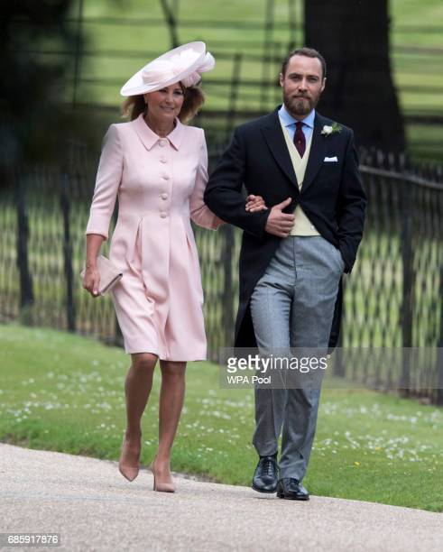 Brother of Pippa James Middleton escorts his mother Carole Middeleton as they arrive for the wedding ceremony of Pippa Middleton to James Matthews at...
