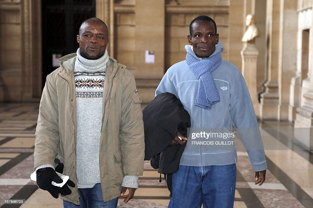 Brother of the late Firmin Mahe, Dahou Koulai Jacques (R) arrives to court in Paris on December 7, 2012 during the trial of four French former soldiers, including a colonel, for killing a man in Ivory Coast in 2005 during a peacekeeping mission in the west African country. The accused say they acted under orders to kill Firmin Mahe, who was suffocated to death while travelling in a French military vehicle. Mahe's death on May 13, 2005, led to the sacking of General Henri Poncet, who was in command of the 4,000-strong peacekeeping mission.