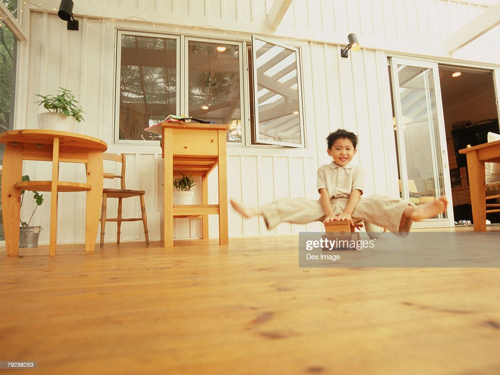 Brother playing with wooden toy car : Stock Photo