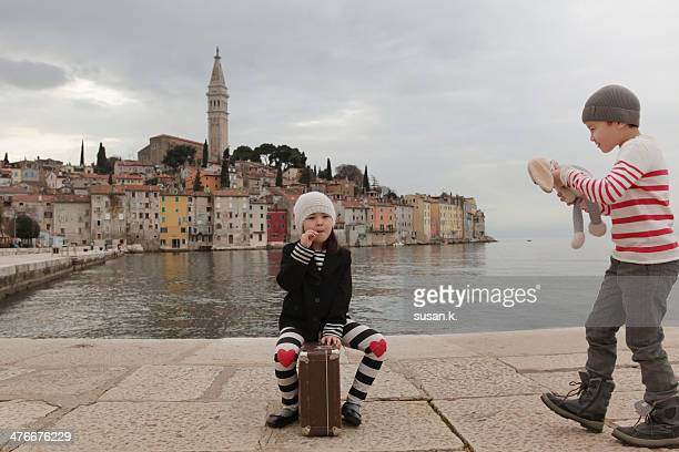 Brother & sister goofily posing by Rovinj harbour