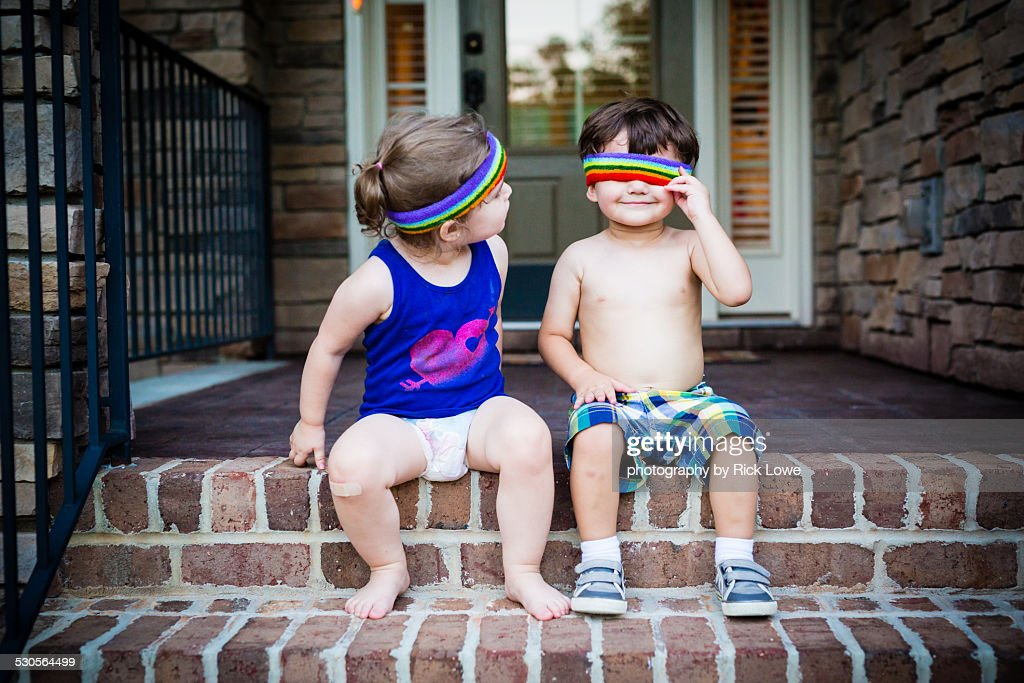 Kids playing on front steps with headbands
