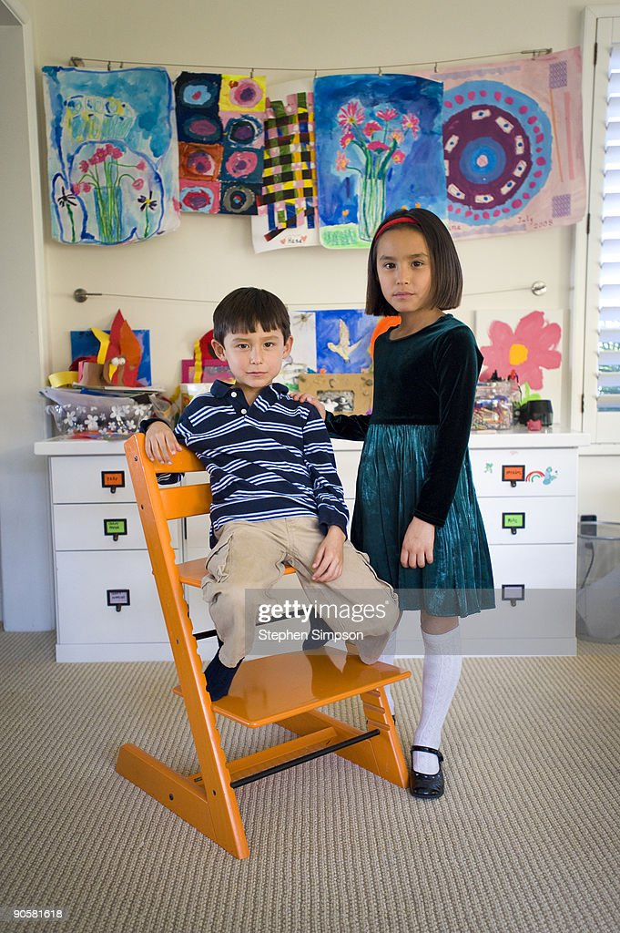brother &sister pose in front of their artwork : Stock Photo
