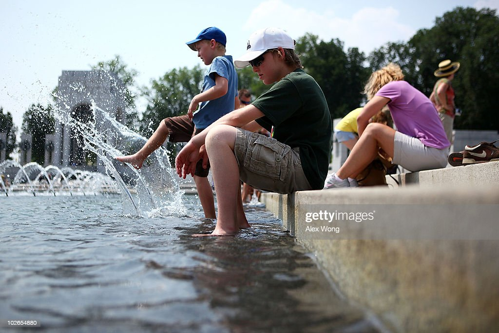 Brothers Allen Peters (L) and Derek Peters (R) of Shavertown, Pennsylvania, cool themselves off in a fountain at the World War II Memorial during the season's first heat wave July 6, 2010 in Washington, DC. The National Weather Service has issued a heat advisory for part of the Northeast, mid-Atlantic and parts of Michigan and Kentucky with temperatures in some areas predicted to reach 100 degrees.