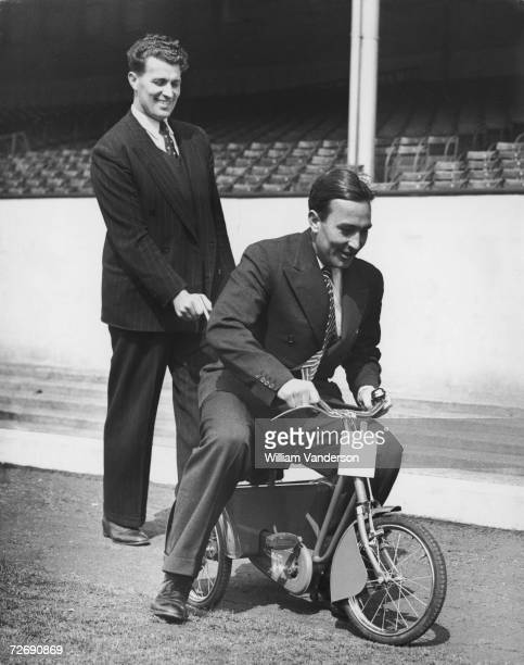 Brothers and fellow Arsenal footballers Leslie and Denis Compton riding one of the tricycles donated to players families by Aberdale Cycles at the...