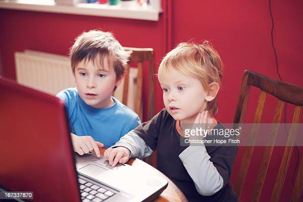 Brothers at a computer