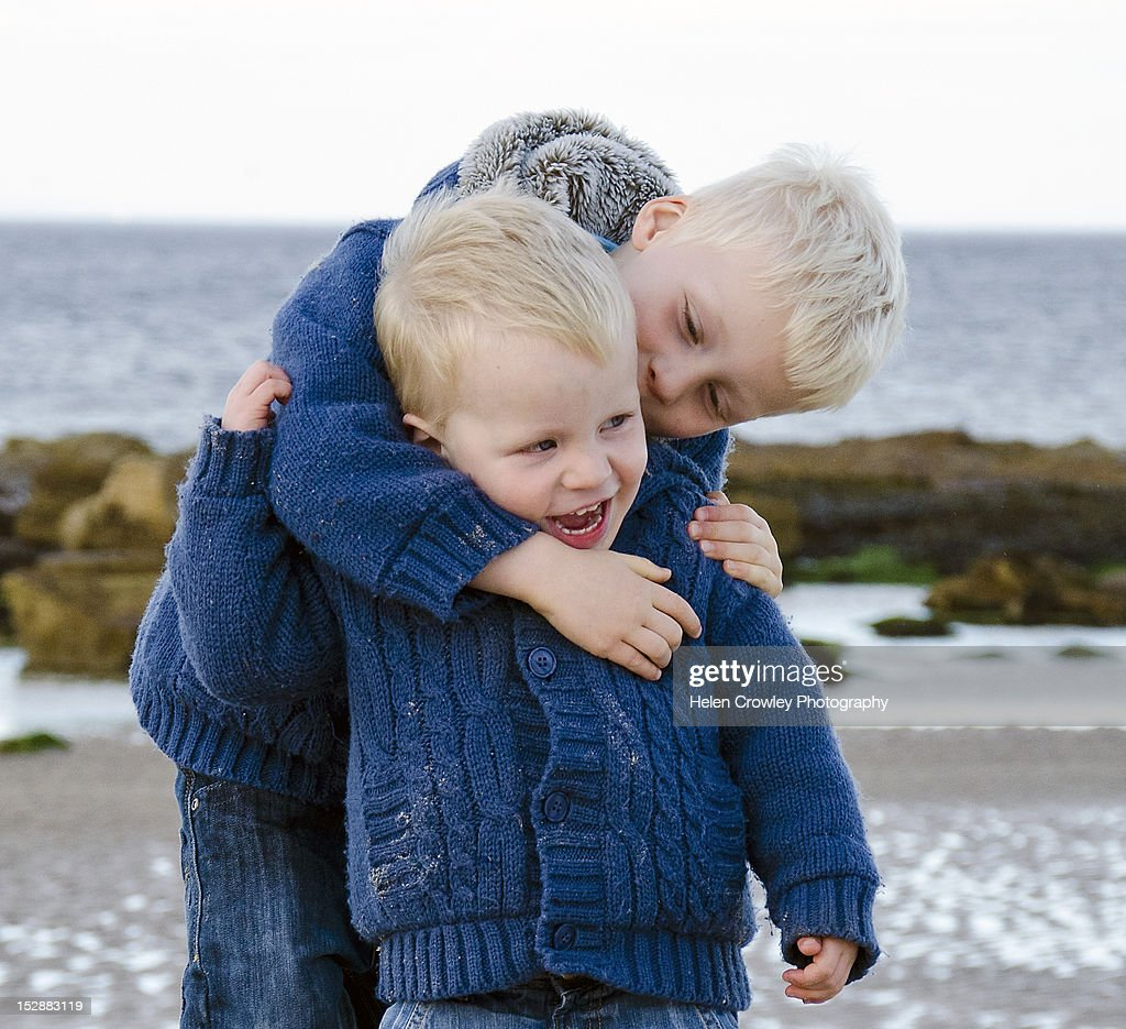 Brothers at beach : Stock Photo