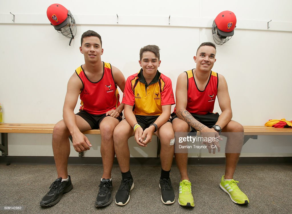 Brothers Ayden McGregor-Baptista, Dylan McGregor-Baptista and Marcus McGregor-Cassady of South Australia pose for a photo during day 2 of the National Indigenous Cricket Championships on February 9, 2016 in Alice Springs, Australia.