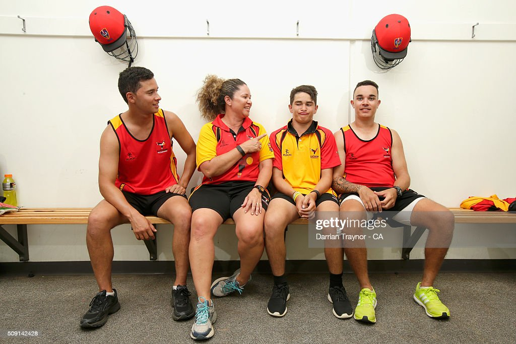 Brothers Ayden McGregor-Baptista, Dylan McGregor-Baptista and Marcus McGregor-Cassady of South Australia pose for a photo with their Team Manager and Mother Tanya McGregor during day 2 of the National Indigenous Cricket Championships on February 9, 2016 in Alice Springs, Australia.