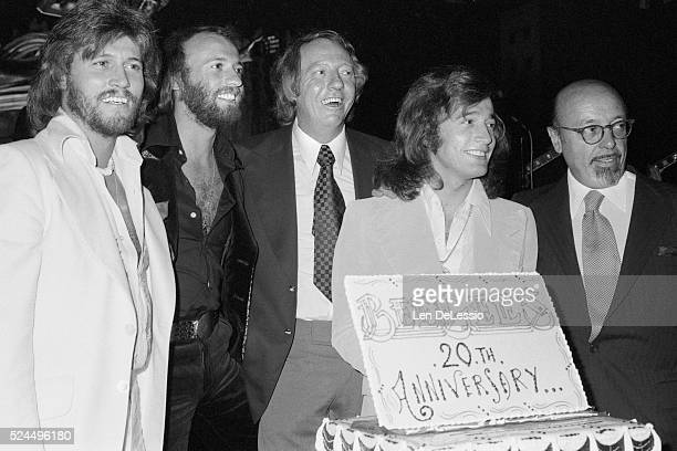 Brothers Barry Gibb Maurice Gibb and Robin Gibb with their impresario Robert Stigwood and Turkish producer Ahmet Ertegun at a party celebrating the...
